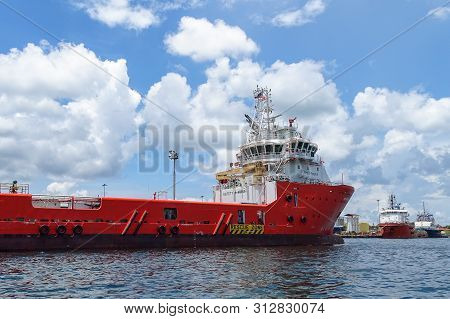 Labuan,malaysia-sept 23,2018:the Big Red Offshore Oil And Gas Supply Vessel In Labuan Island,malaysi