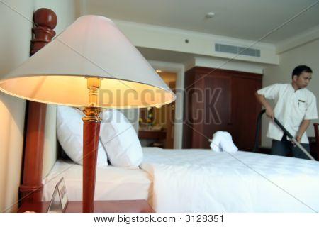 Housekeeping Working In Hotel Room