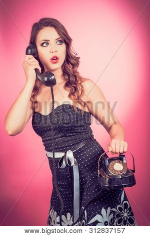 Woman holding a vintage telephone