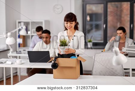 business, new job and corporate concept - happy smiling asian businesswoman or female employee with her personal stuff at office