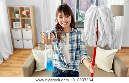 cleaning, housework and housekeeping concept - asian woman or housewife with mop and detergent sprayer at home