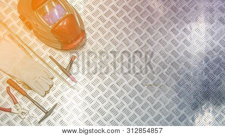 Welding Equipment With Welding Mask, Leather Gloves. Top View