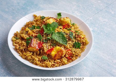 Vegetarian Paneer Biryani At Light Blue Background.