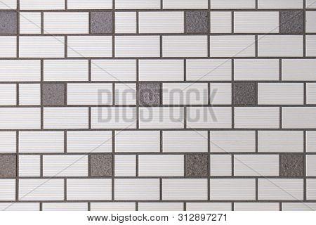 Gray brick wall backgrund close-up