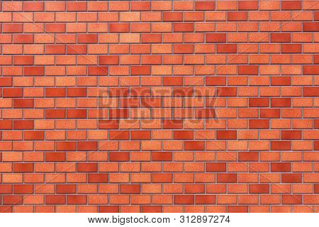 Red brick wall background close-up