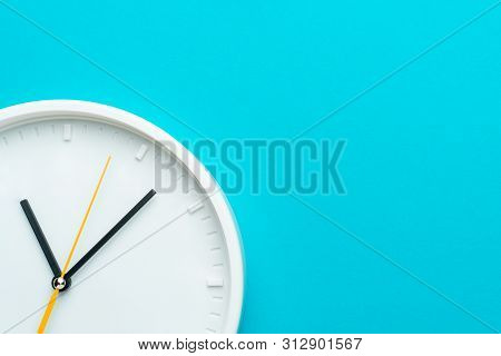Part Of White Wall Clock With Yellow Second Hand Hanging On Wall. Close Up Image Of Plastic Wall Clo