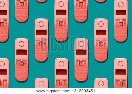 Pattern Image Of Dect Phones Turning Into A Toy Phones Of Trendy Coral Color On Blue Background. The