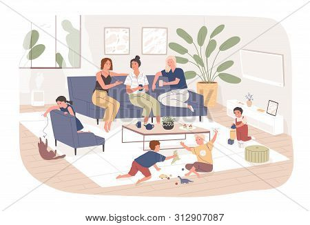 Group Of Female Friends Sit On Comfy Sofa, Drink Tea And Chatter While Their Children Play. Young Mo
