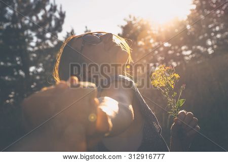 poster of Running in sunset. Lifestyle concept. Hipster woman running in sunset in meadow. Healthy lifestyle. People lifestyle. Hipster people lifestyle. Running together. People. LIfestyle. Couple running happy in sunset.