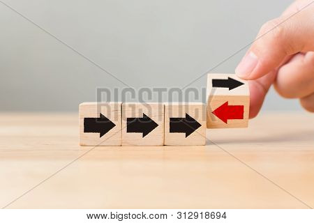 Hand Flip Over Wooden Cube Block With Red Arrow Facing The Opposite Direction Black Arrows, Unique,