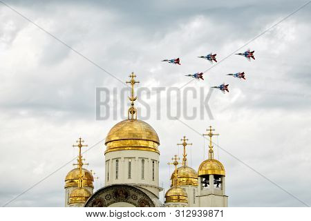 Russia, Magnitogorsk, - July, 19, 2019. Russian Attack Aircraft Fulcrum-a Mig 29 Fly Over An Orthodo