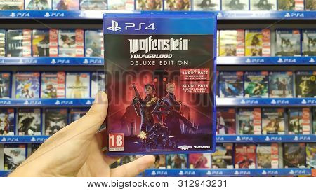 Bratislava, Slovakia, July 23, 2019: Man Holding Wolfenstein Youngblood Deluxe Edition Videogame On