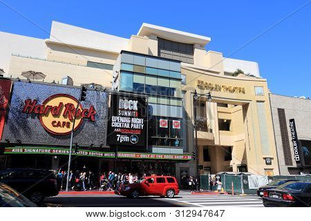 Los Angeles, Usa - April 5, 2014: People Visit Hard Rock Cafe In Hollywood. As Of 2015 There Are 191