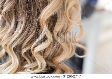 Beautiful Hairstyle Of Young Woman After Hair Wrapping And Styling