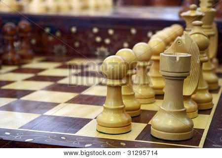 Chess Pieces On Wooden Playboard