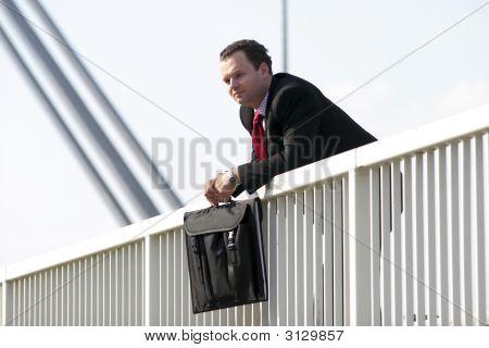 Businessman On Bridge