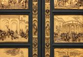 Detail of the Doors of Paradise in Battistero di San Giovanni Florence Italy. poster