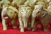 Handcraft wooden elephant sculptures made in India poster