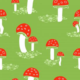 Red Fly Agaric Mushrooms Seamless Pattern On Green Background.