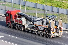 Transportation Of Equipment For Cutting Old Asphalt On A Trailer Truck Platform On The Highway