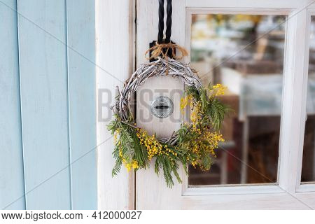 Front Door With Wreath Of Mimosa Yellow Flowers. Easter Wreath. Spring Decoration On Wooden Door Of