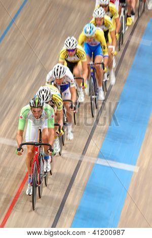 VIENNA,  AUSTRIA - SEPTEMBER 28  Andreas Graf (Austria) leads the peloton in the men's scratch race of an indoor cycling meeting on September 28, 2012 in Vienna, Austria.