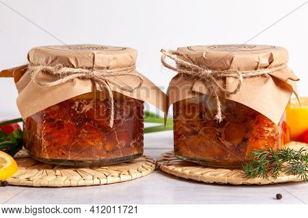 Homemade Canned Meat From Farm Poultry-goose And Duck. Glass Jars With Canned Poultry Meat.