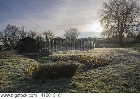 Landscape View Across Large Garden And Fields In Winter With Frost And Summerhouse Shed In Morning S