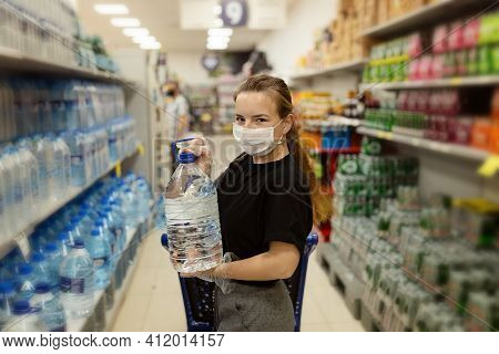 Buyer Wearing A Protective Mask.shopping During The Pandemic.emergency To Buy List.water Supplies Sh