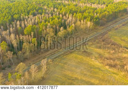 A Vast Plain. Photo Taken With A Flying Drone, View From High Altitude. A Single-track Railway Line