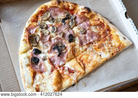 Family Pizza, Half Of Oval, Consists Of Two Types, Margarita, Prosciutto Fungi. Food Delivery Concep