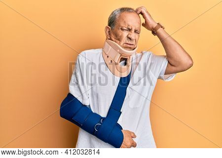 Handsome mature senior man wearing cervical collar and arm on sling confuse and wondering about question. uncertain with doubt, thinking with hand on head. pensive concept.