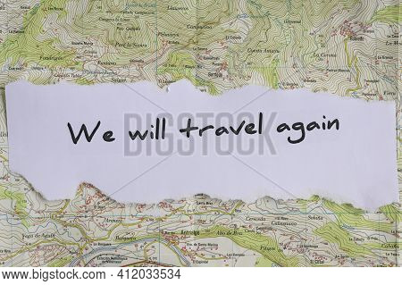 The Motivational Phrase We Will Travel Again Written On A Map\nconceptual Of Travel