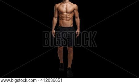 Cropped Image A Sportive Man With Muscular Body, Naked Torso Posing At Studio. Black Background. Men