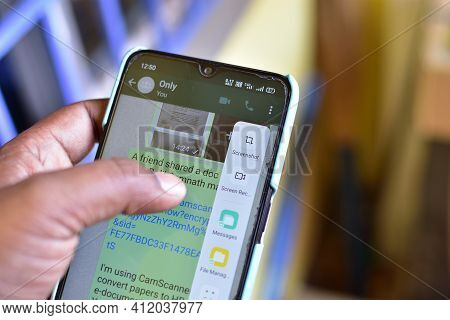 Jhargram, West Bengal, India - February 28, 2021: Taking Screenshot Of An Whatsapp Chat On A Mobile