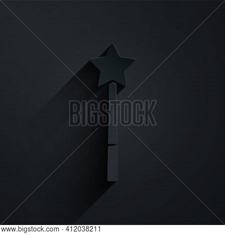Paper Cut Magic Wand Icon Isolated On Black Background. Star Shape Magic Accessory. Magical Power. P