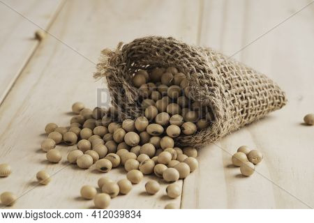 Soybean Seed In Sack On Table With Copy Space. Soybean Is Healthy Diet Food Which High Protein Low F