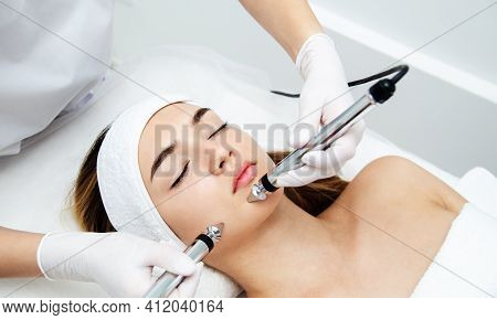 Woman Getting Beauty Treatment In Medical Spa Center. Skin Care And Rejuvenation Concept. Beautician