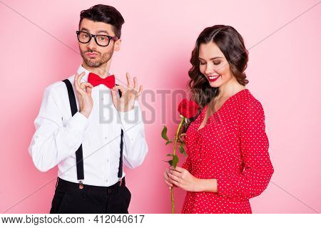 Photo Of Young Attractive Couple Arrogant Man Correct Fix Bowtie Happy Smile Girl Hold Rose Date Iso
