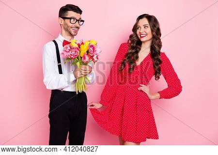 Photo Of Young Cheerful Couple Guy Present Girlfriend Flower Bouquet Feelings Valentine Day Isolated