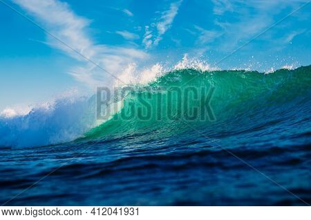Turquoise Waves In Ocean. Breaking Wave With Sun Light