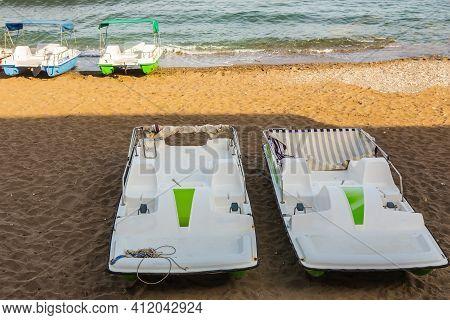 Pleasure Catamarans On The Sea Beach In Summer