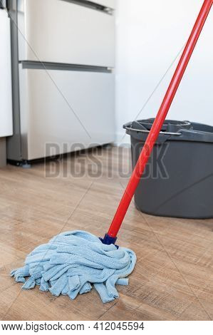 Close Up Of A Mop In Kitchen.concept Of Cleanliness At Home
