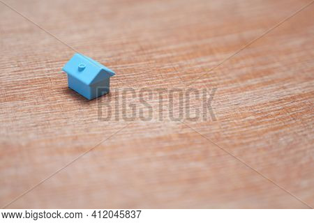 Minimal Design One Single Miniature House With Copy Space. Blue Toy Home Property Market Housing Mor