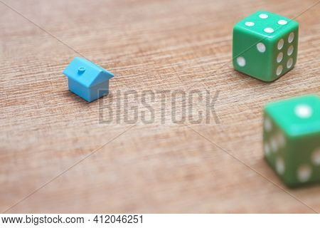 Property Risks And Chances Concept. Miniature House And Dice On Wood Background Mortgage Loans Real