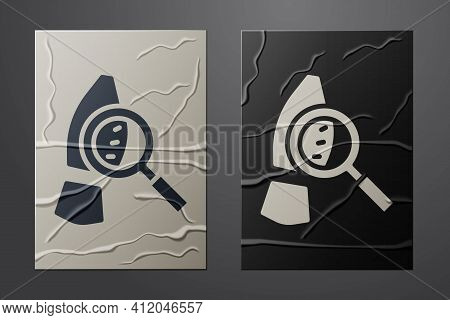 White Magnifying Glass With Footsteps Icon Isolated On Crumpled Paper Background. Detective Is Inves