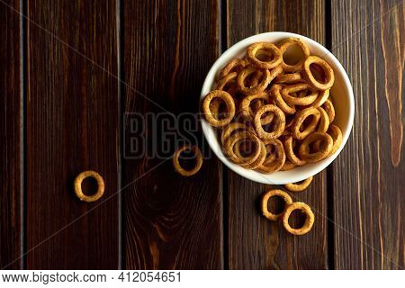 Small Wheat Bagels In White Ceramic Bowl On Dark Rustic Table, Top View, Copy Space
