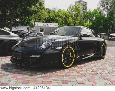 Kiev, Ukraine - May 14, 2011: Black Supercar Porsche 911 (997) Turbo Techart Gt Street In The City