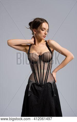 Elegant Slim Woman In Skirt And Corset
