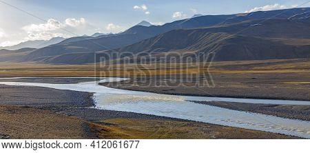 Landscape With Road On Wide Floodplain Of  Mountain River. Panorama With  Road Along The Riverbed An